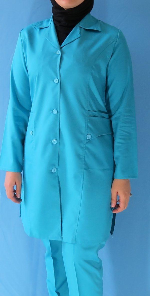 مانتو شلوار فیروزه ای2 600x1180 - مانتو شلوار آبی فیروزه ای مدل سه جیب